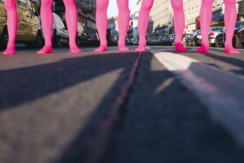 "Members of Assocreation. Performance in pink stockings, 2004. Group exhibition ""Making it 2 – die sprache der straße"". Schönbrunner Straße, Wien (AT). Photo: Franco Winter."