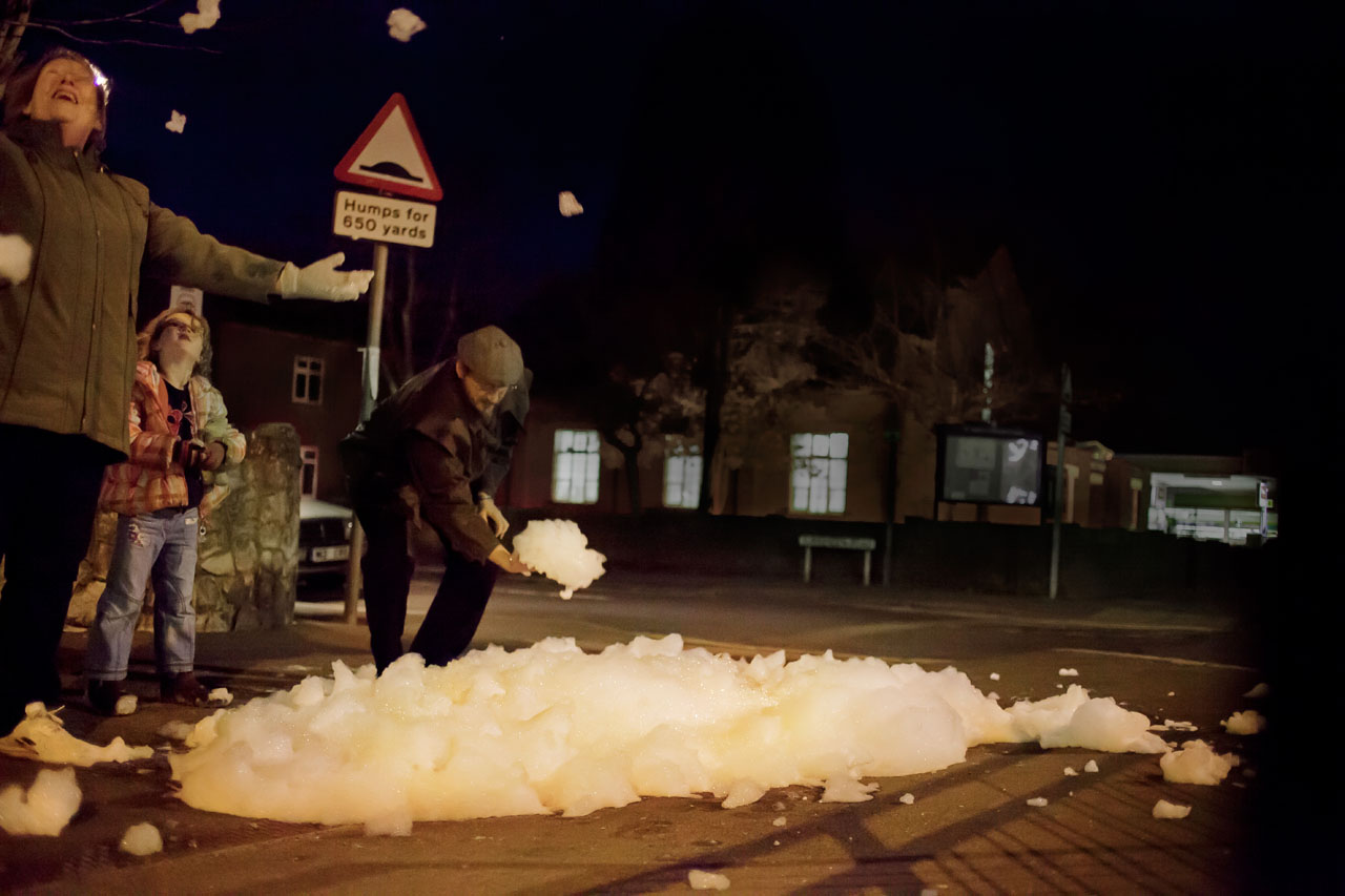 "Sewer Foamies. Installation and happening, 2014. ""Cheriton Lights 2014"", Cheriton High Street, Folkestone (United Kingdom). Video still: Assocreation."