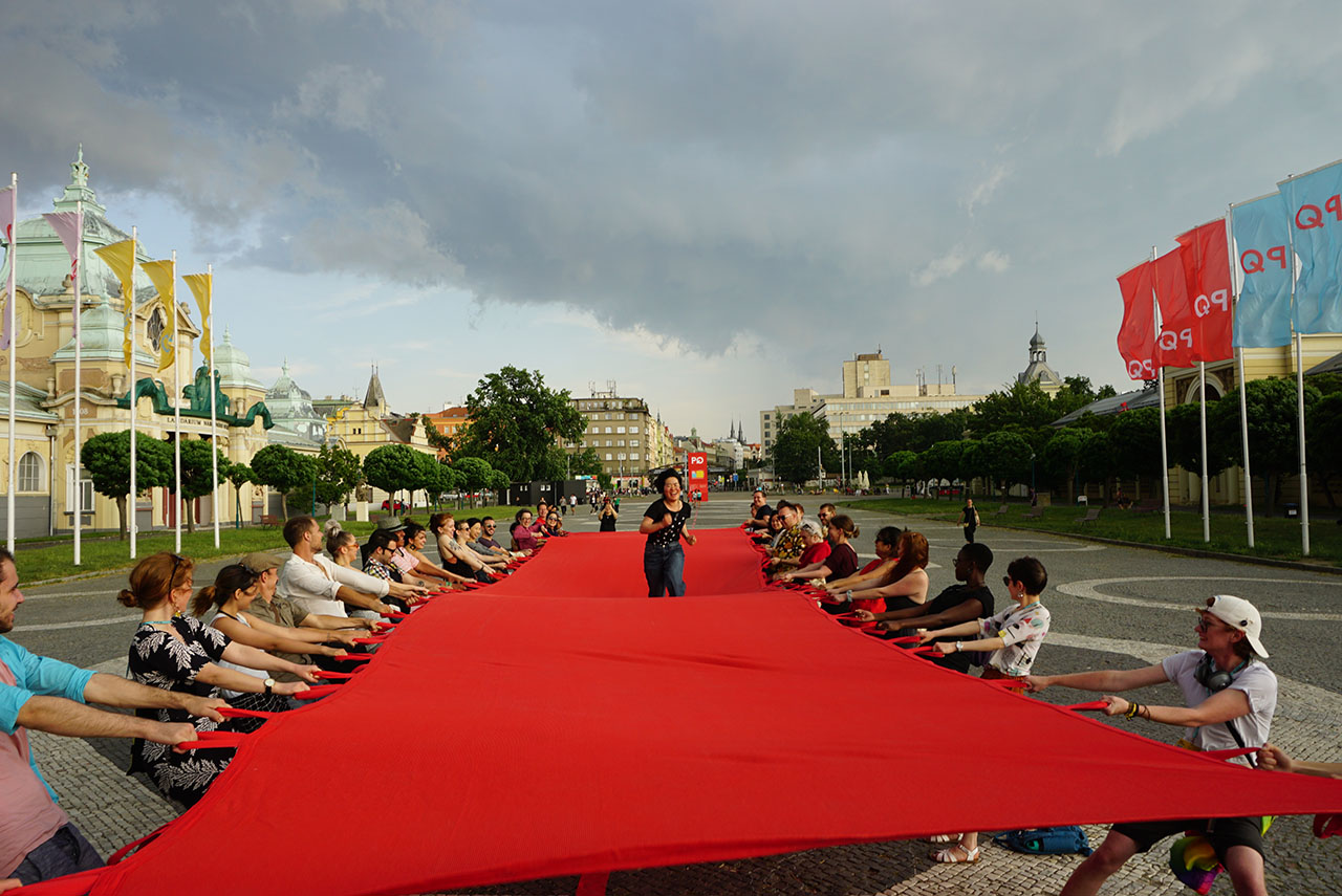 "Red Crossing. Participatory public performance. Group exhibition: ""Formations"", Prague Quadrennial 2019, Prague Exhibition Grounds (Výstaviště Praha), Prague, Czech Republic."