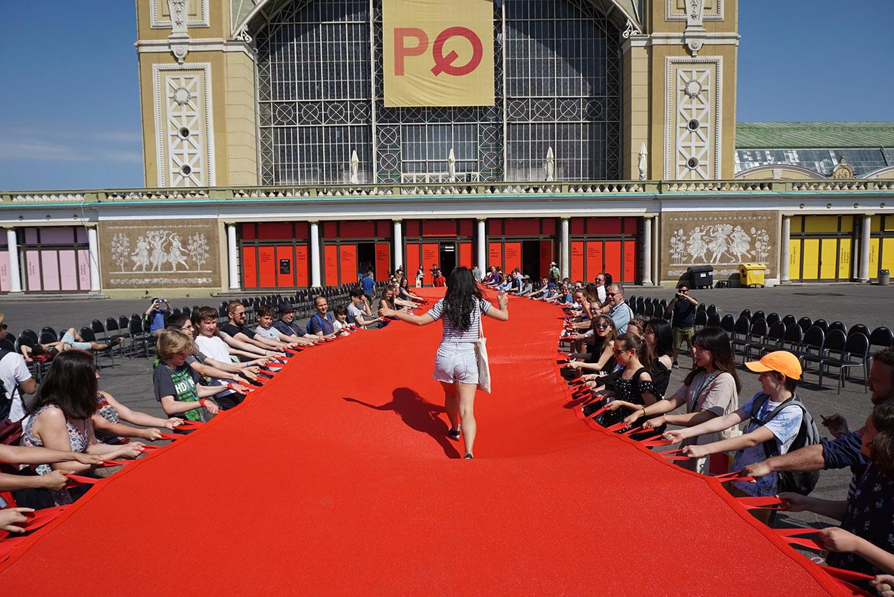 """Red Crossing. Participatory public performance. Group exhibition: """"Formations"""", Prague Quadrennial 2019, Prague Exhibition Grounds (Výstaviště Praha), Prague, Czech Republic."""