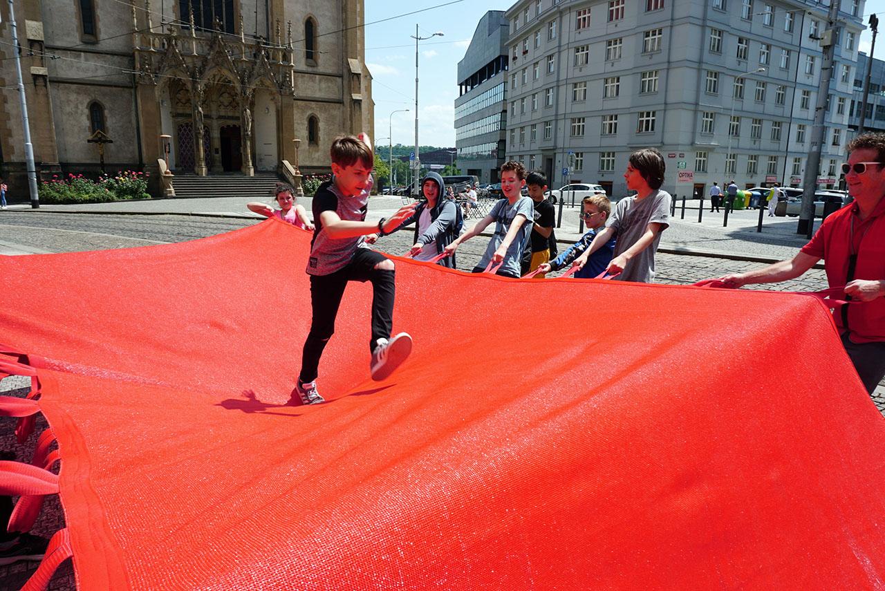 "Red Crossing. Participatory public performance. Group exhibition: ""Formations"", Prague Quadrennial 2019, Strossmayerovo náměstí, Prague, Czech Republic."