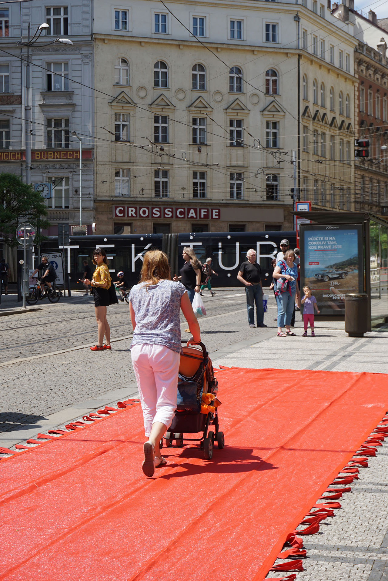 "Red Crossing. Participatory public performance. Group exhibition: ""Formations"", Prague Quadrennial 2019, Strossmayerovo náměstí, Prague, Czech Republic."